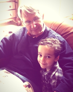 Grandpa and Jack, reading about lizards.