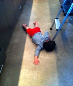 Jack doing yoga on the kitchen floor, unknown pose